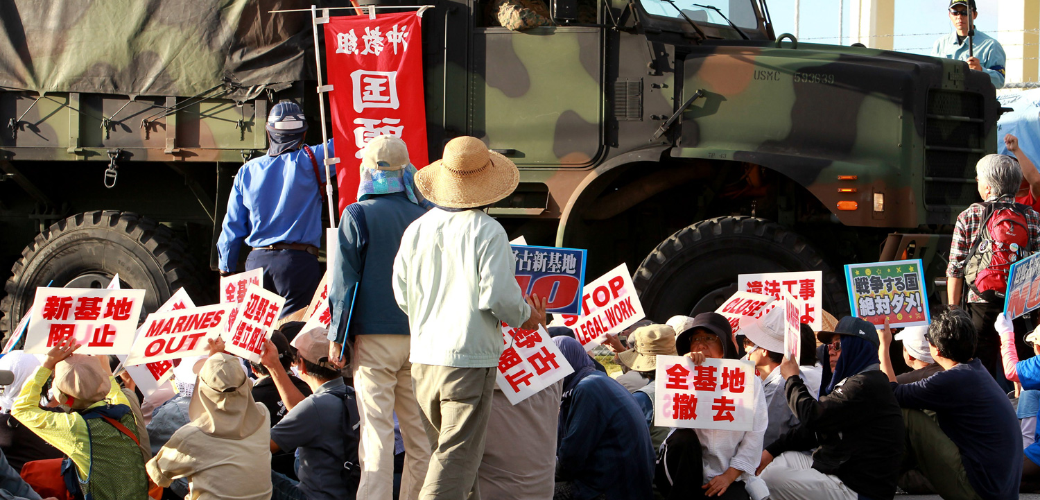 Demonstrators at Camp Schwab, a US military base on the island of Okinawa, Japan, want the world superpower to back off their land. Photo by Hitoshi Maeshiro/epa/Corbis