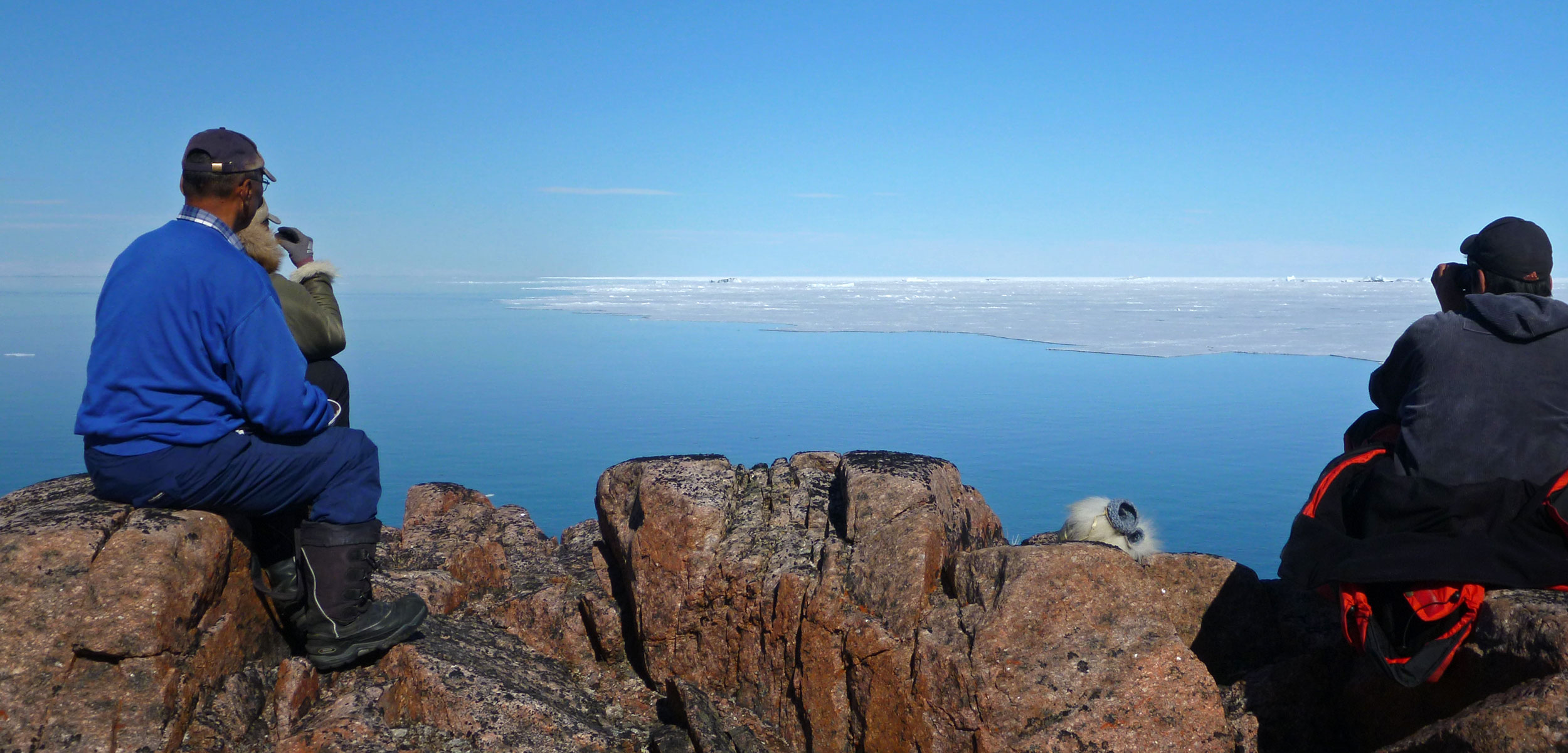 Inuit hunters look out from Inglefield Land
