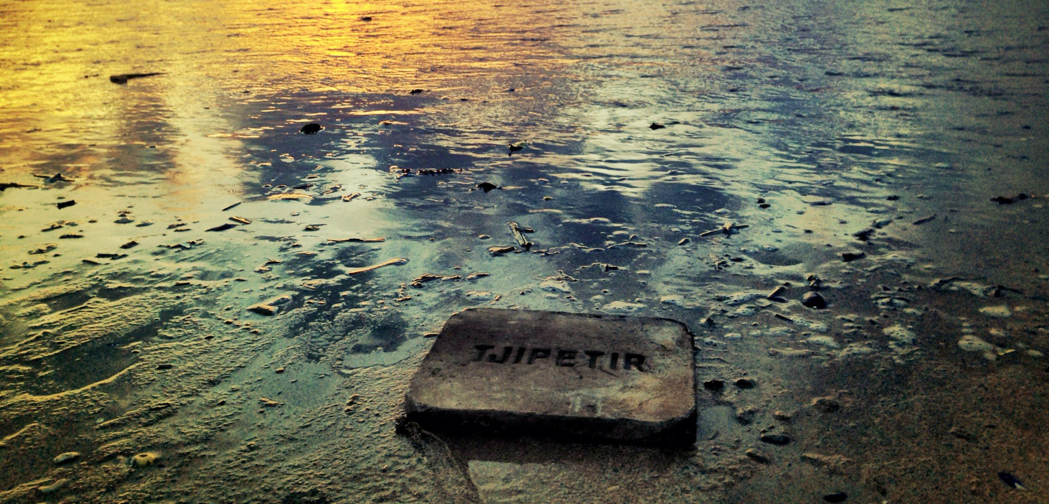 "This rubbery block stamped with ""Tjipetir"" is one of many that have washed up on European beaches since 2012. Photo by Tom Quinn Williams/Tjipetir Mystery"
