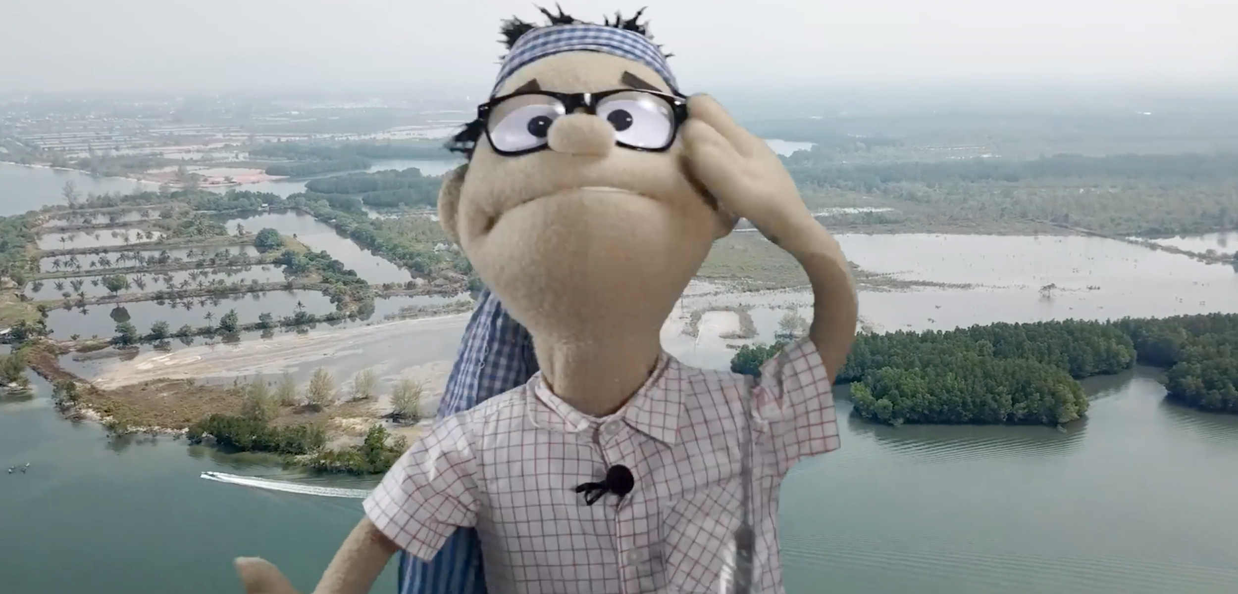 screenshot of a video with a puppet activist