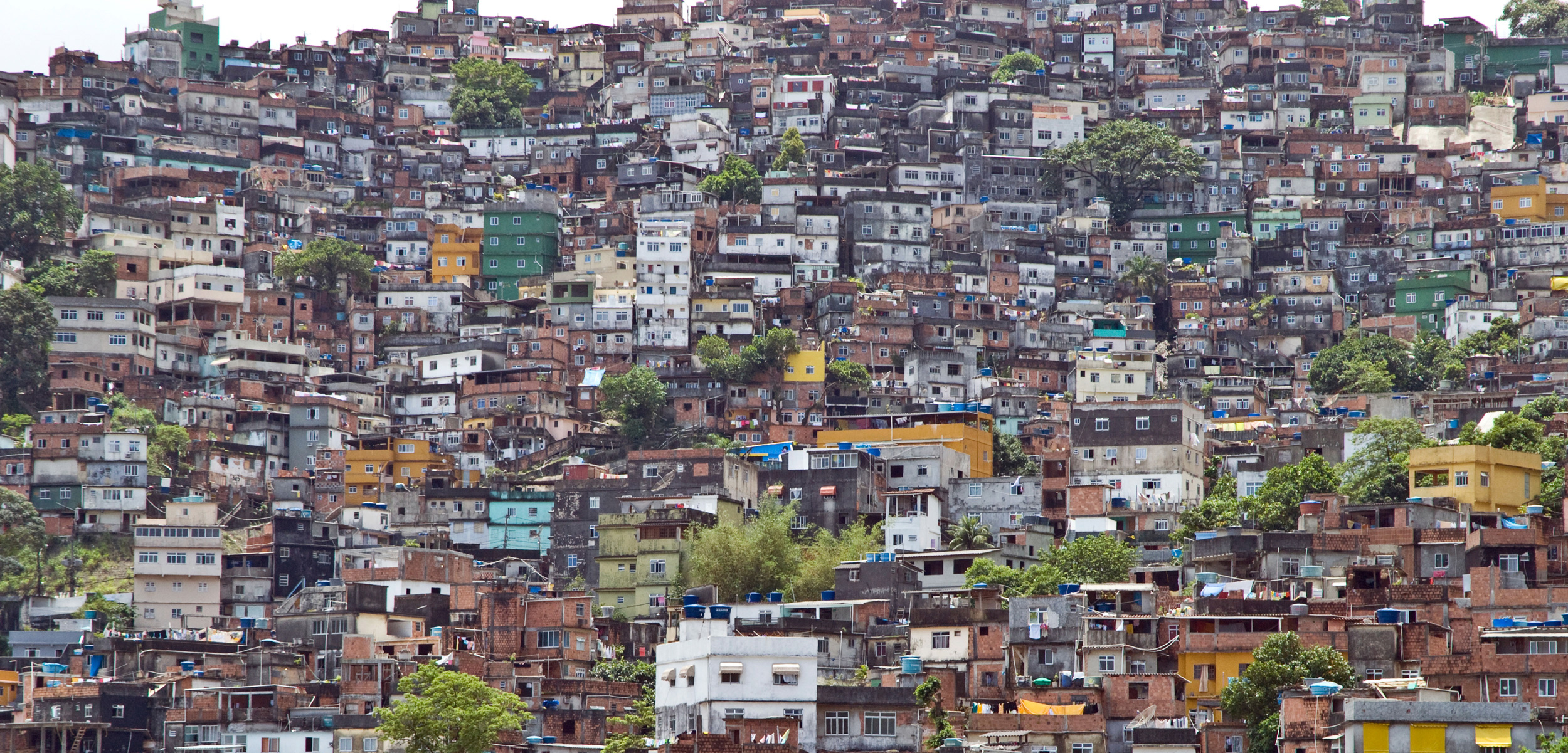 Favelas are the poor neighborhoods on the hillsides above the wealthy enclaves of old Rio de Janeiro. For the most part, residents of the favelas have been left out of the Olympic legacy. Photo by Simon Lowthian/Alamy Stock Photo