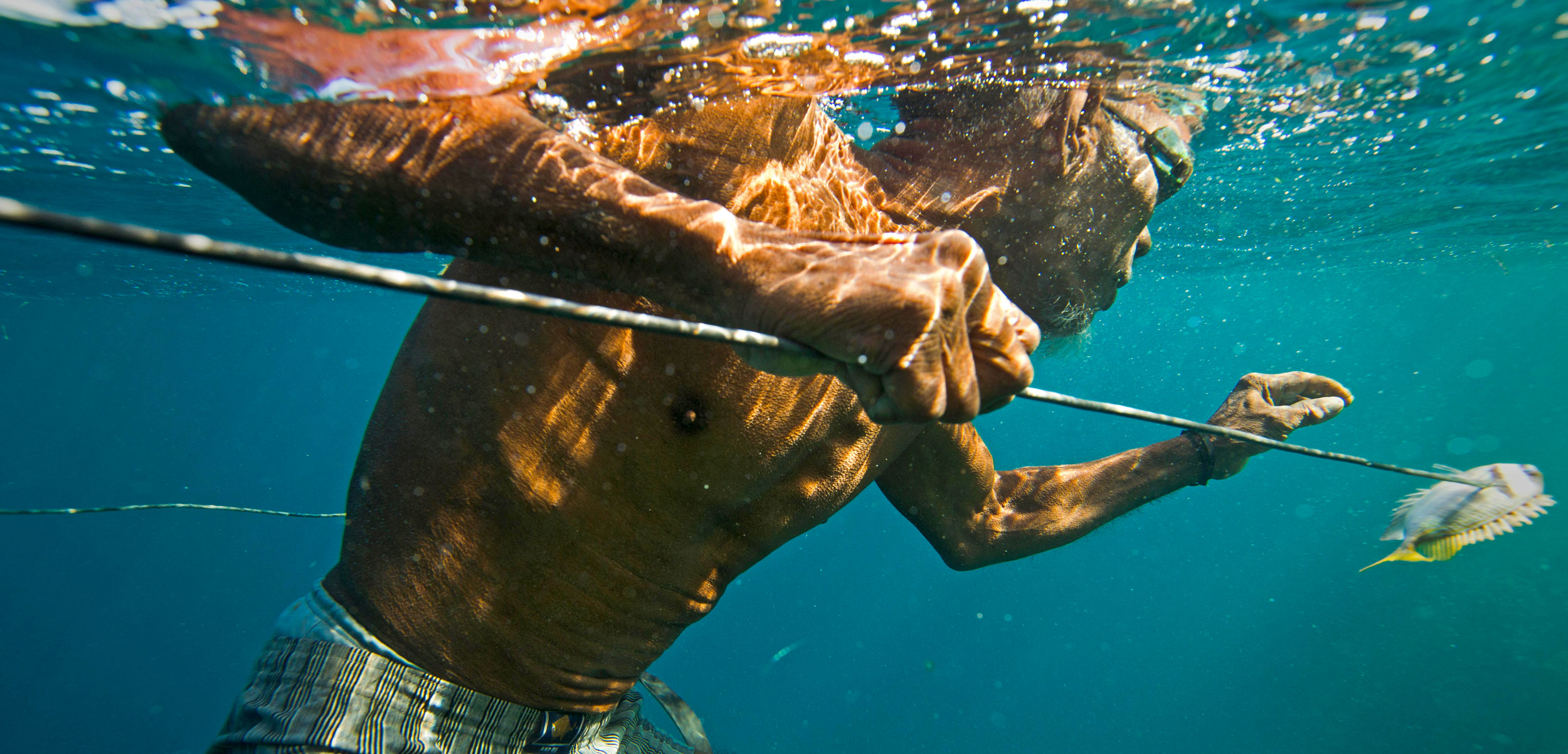 Bajau elder fishing in Sampela, Indonesia