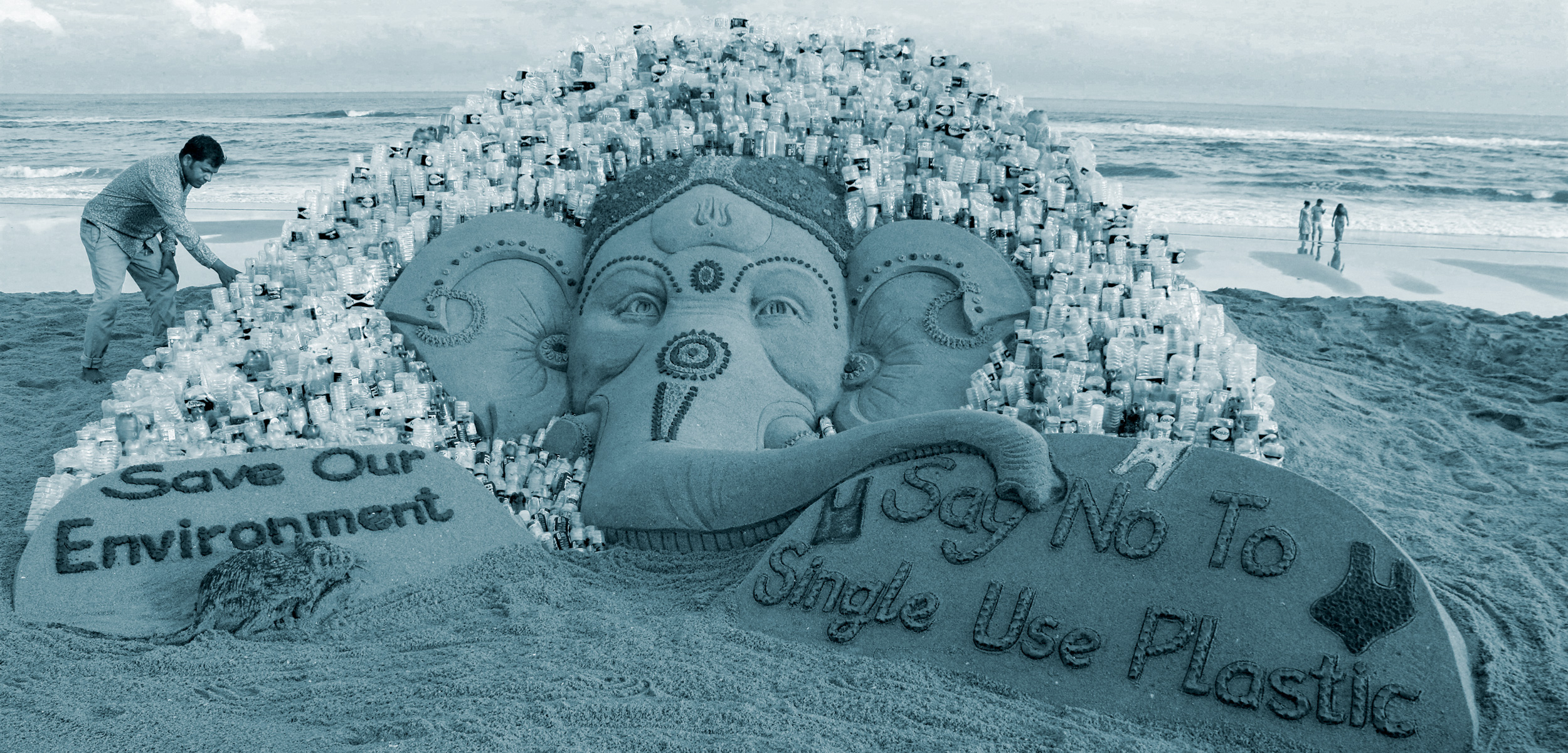 Sudarsan Pattnaik and his sand sculpture of Ganesha