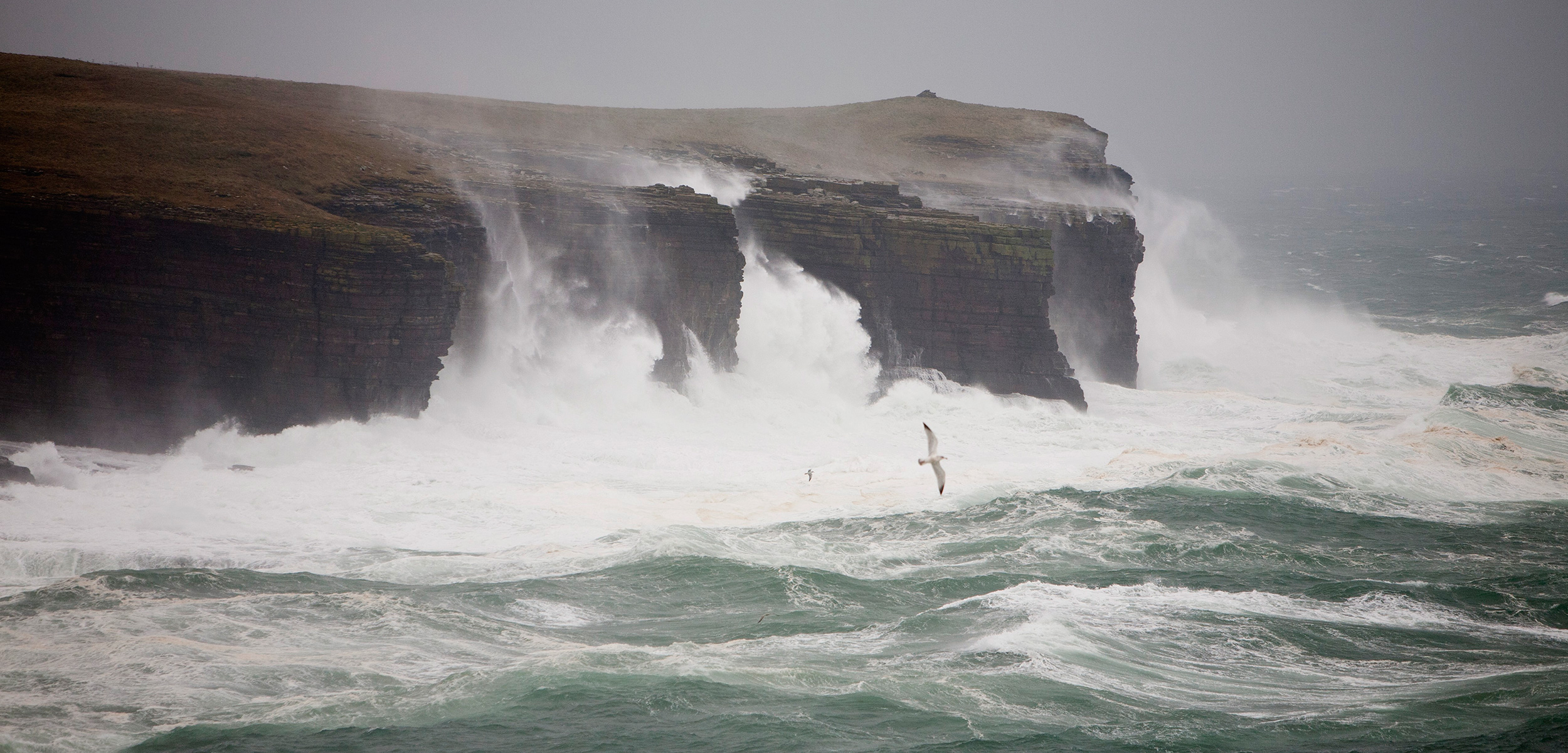 Severe storms threaten coastal archaeological sites in Scotland's Orkney Islands and elsewhere in the world. Photo by Ashley Cooper/Corbis
