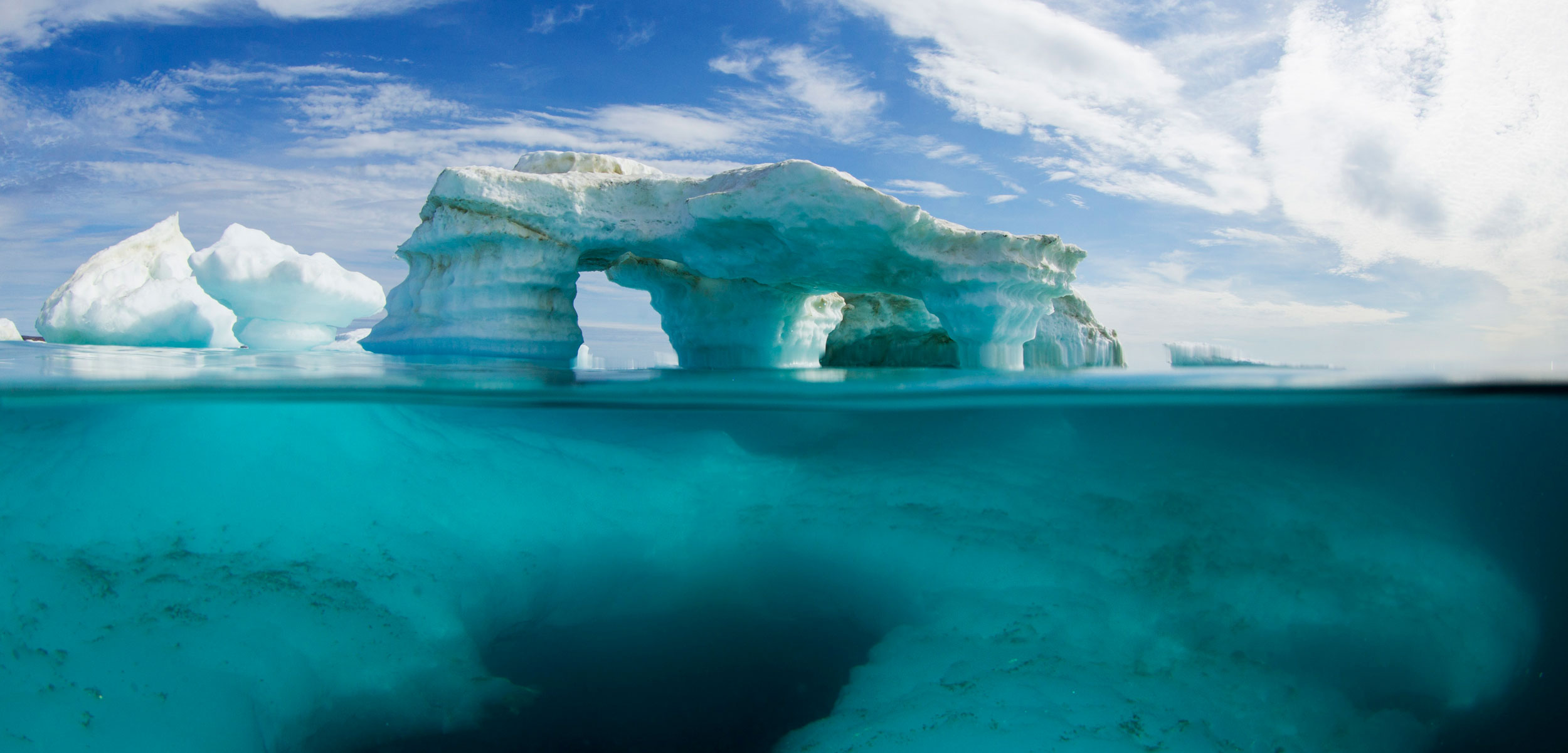 Underwater view of melting iceberg in Harbour Islands on Hudson Bay just south of arctic circle, Repulse Bay, Nunavut Territory, Canada