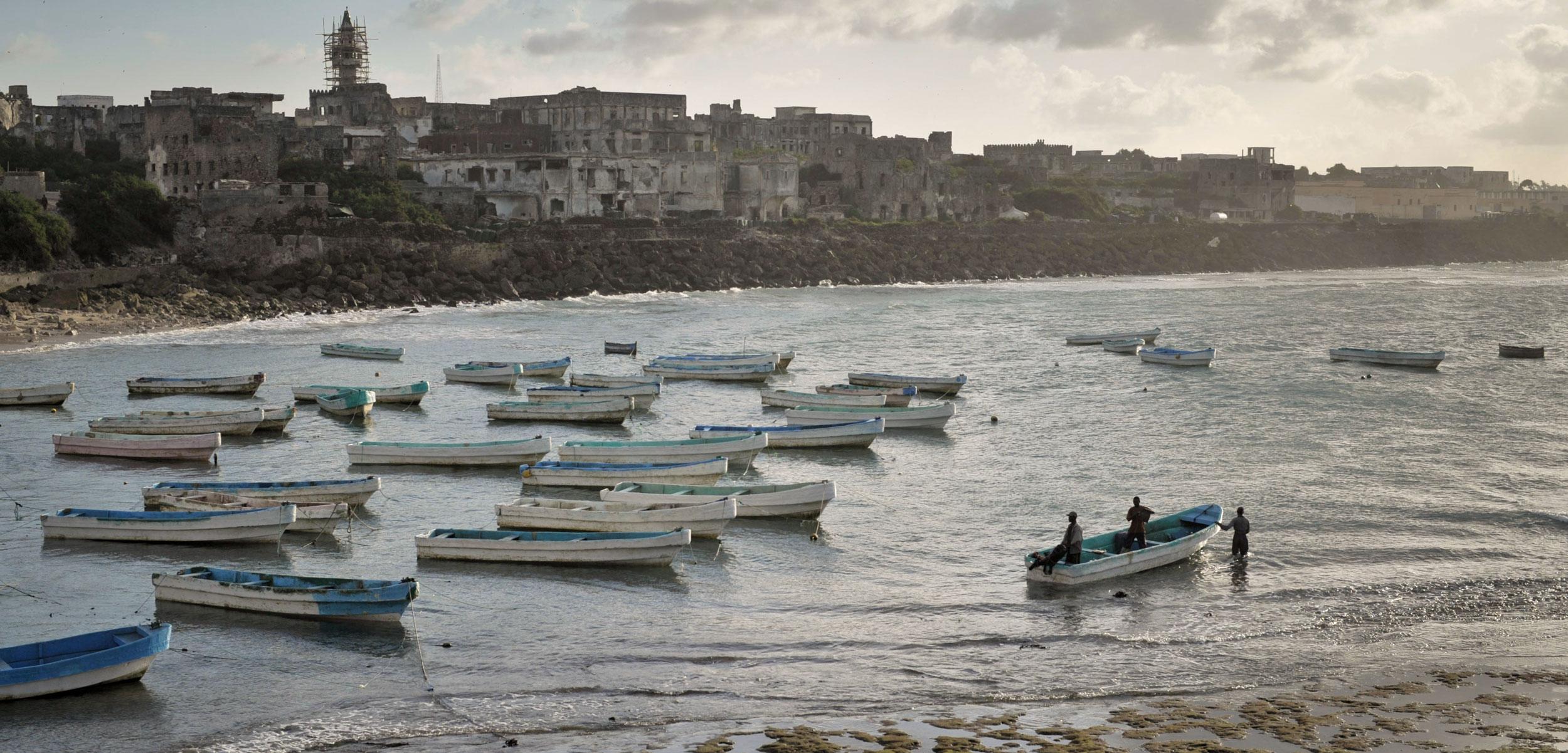 Fishing boats in Mogadishu's old port in Somalia at sunrise