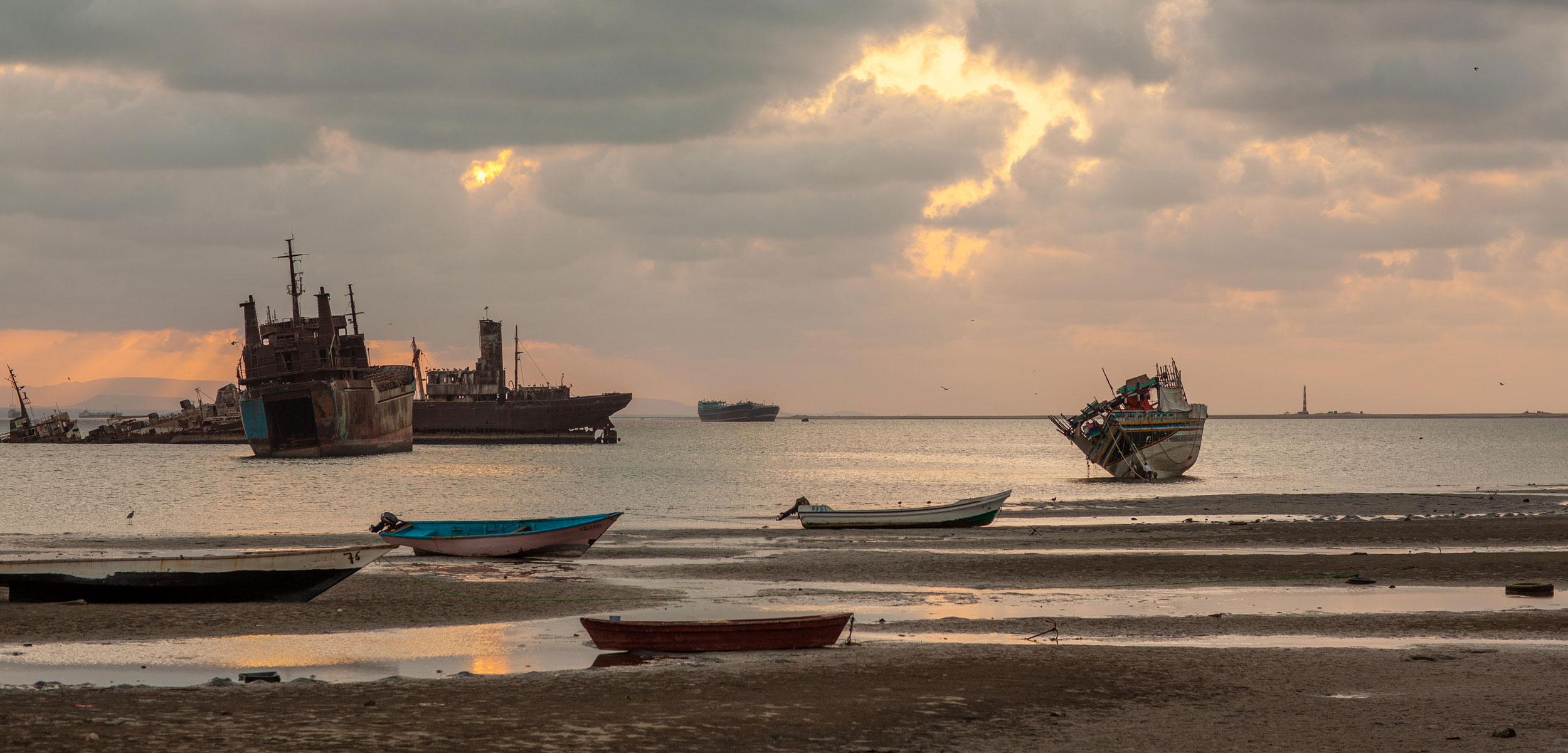 Boats on the beach at sunset, North-Western province, Berbera, Somalia