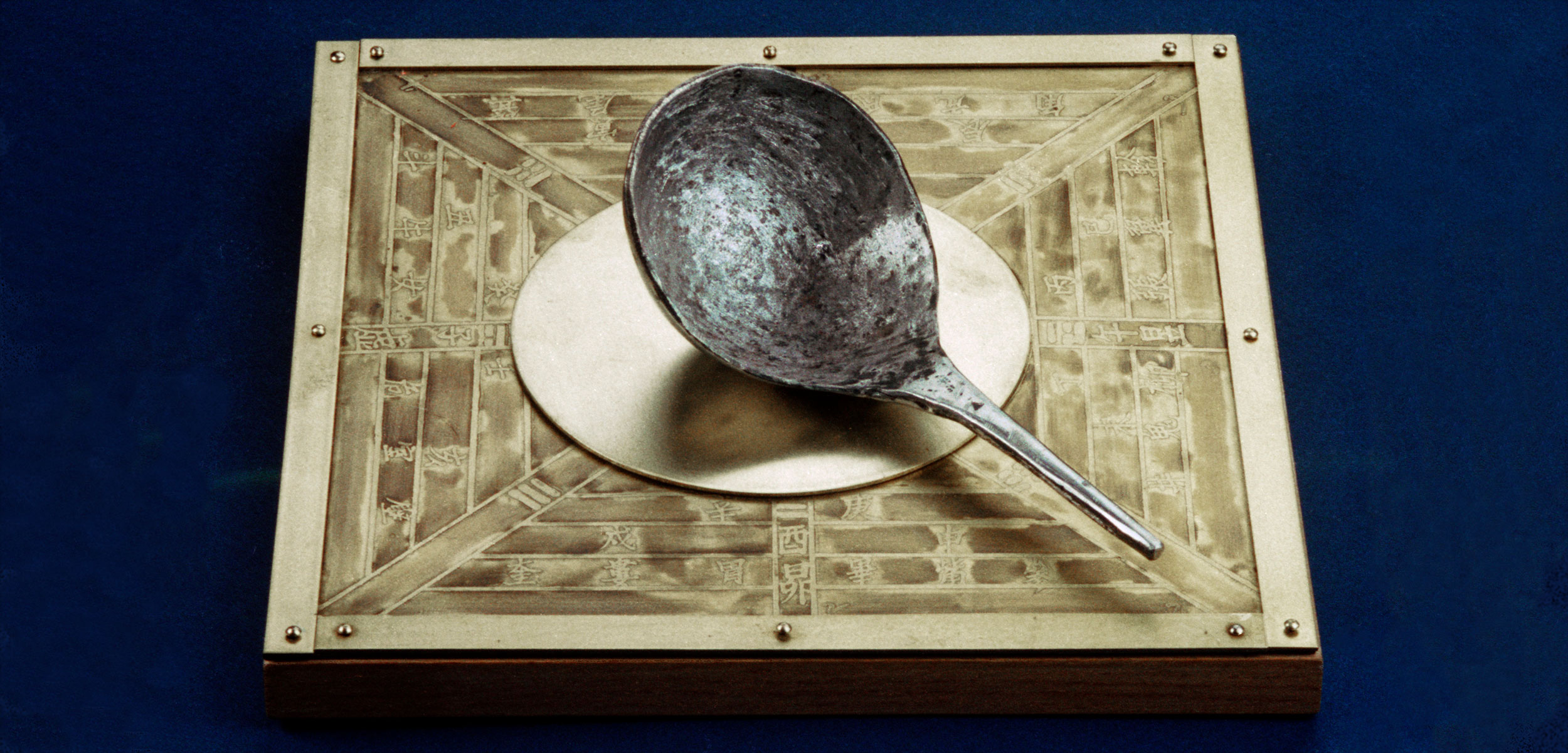 modern replica of a south pointing spoon, an early compass