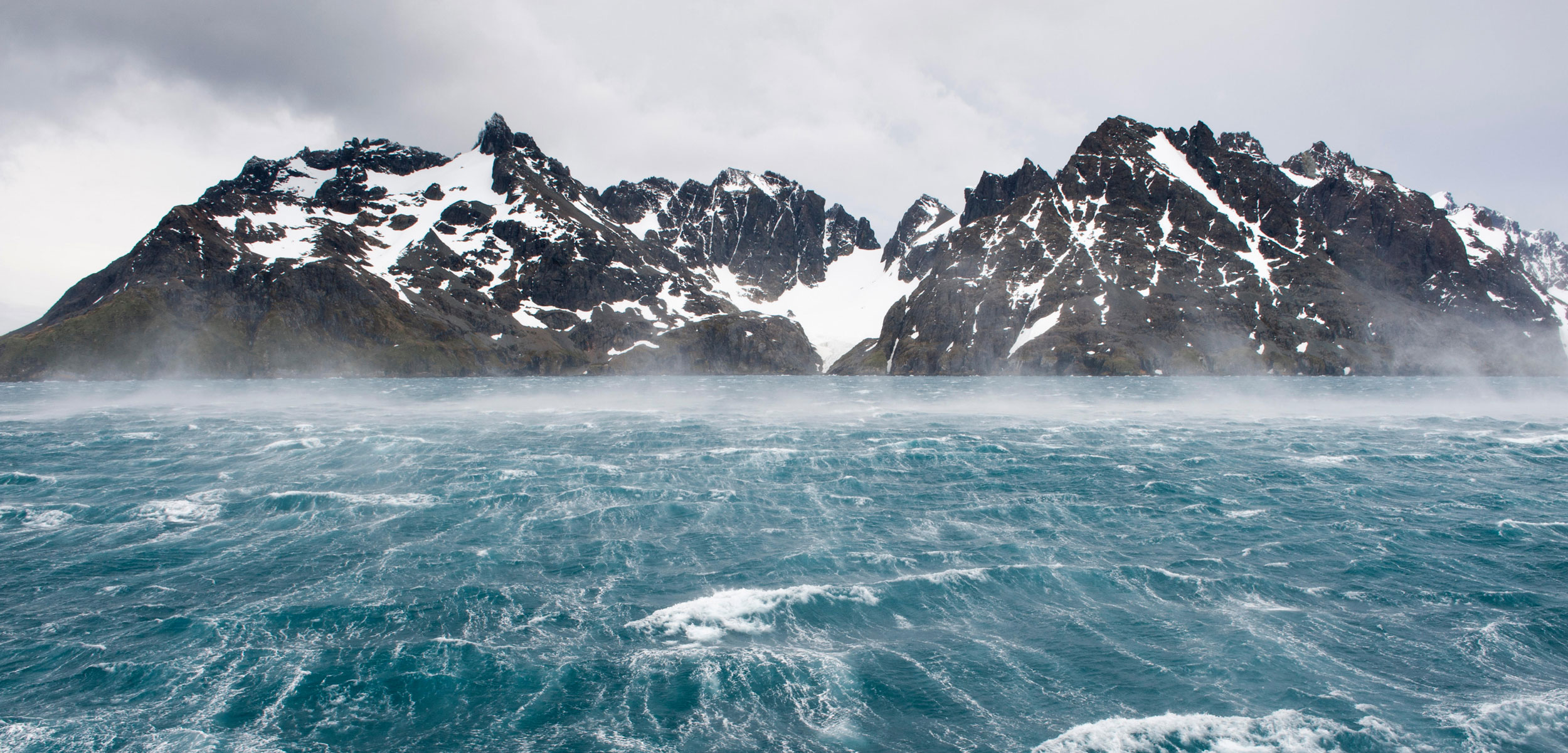 Stormy waters and rugged mountains, Drygalski Fjord, South Georgia Island, Antarctica