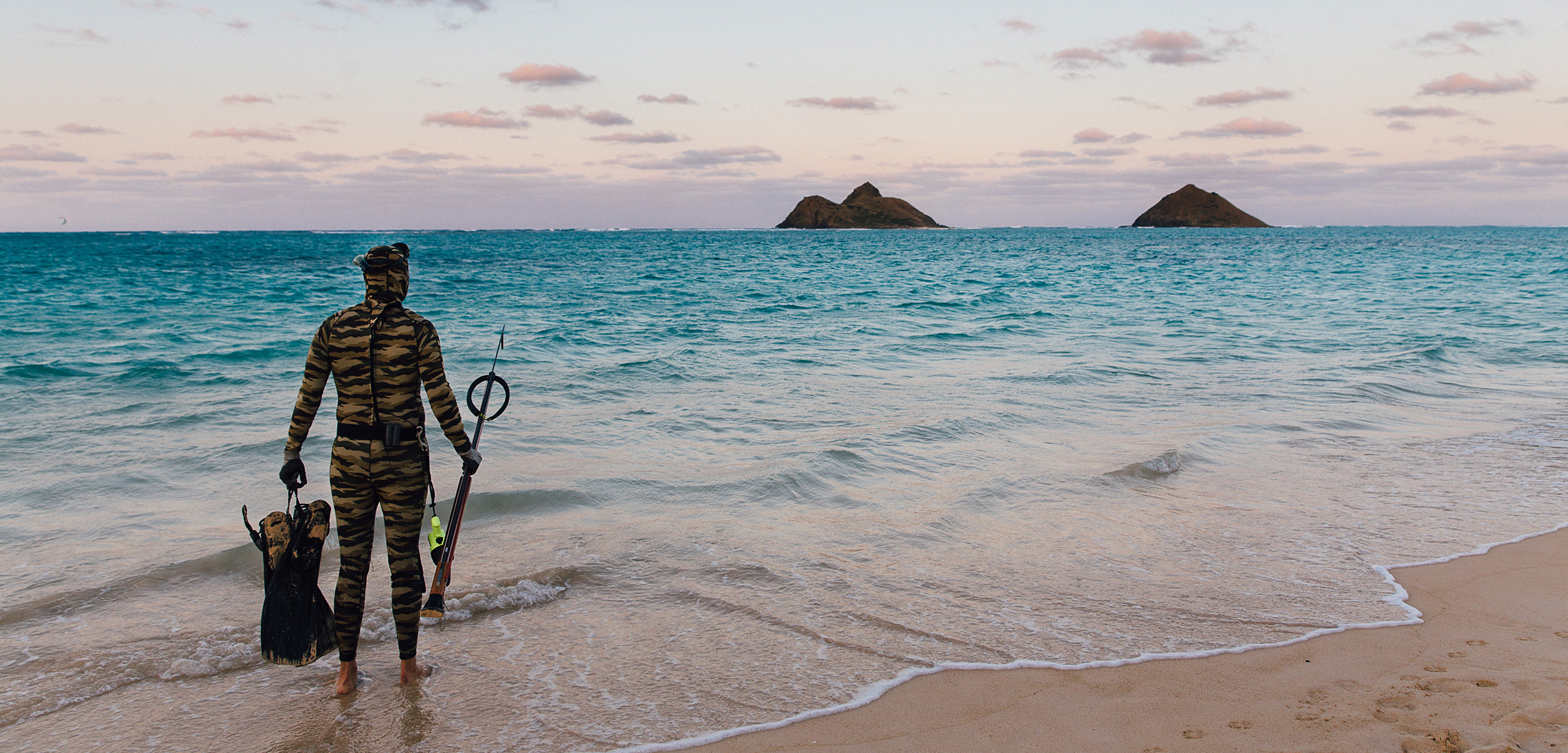 For some Hawaiian residents like Kellen Parenzin of O'ahu, spearfishing is about participating in and forging a spiritual connection to the ecosystem beneath the waves. Photo by Meagan Suzuki