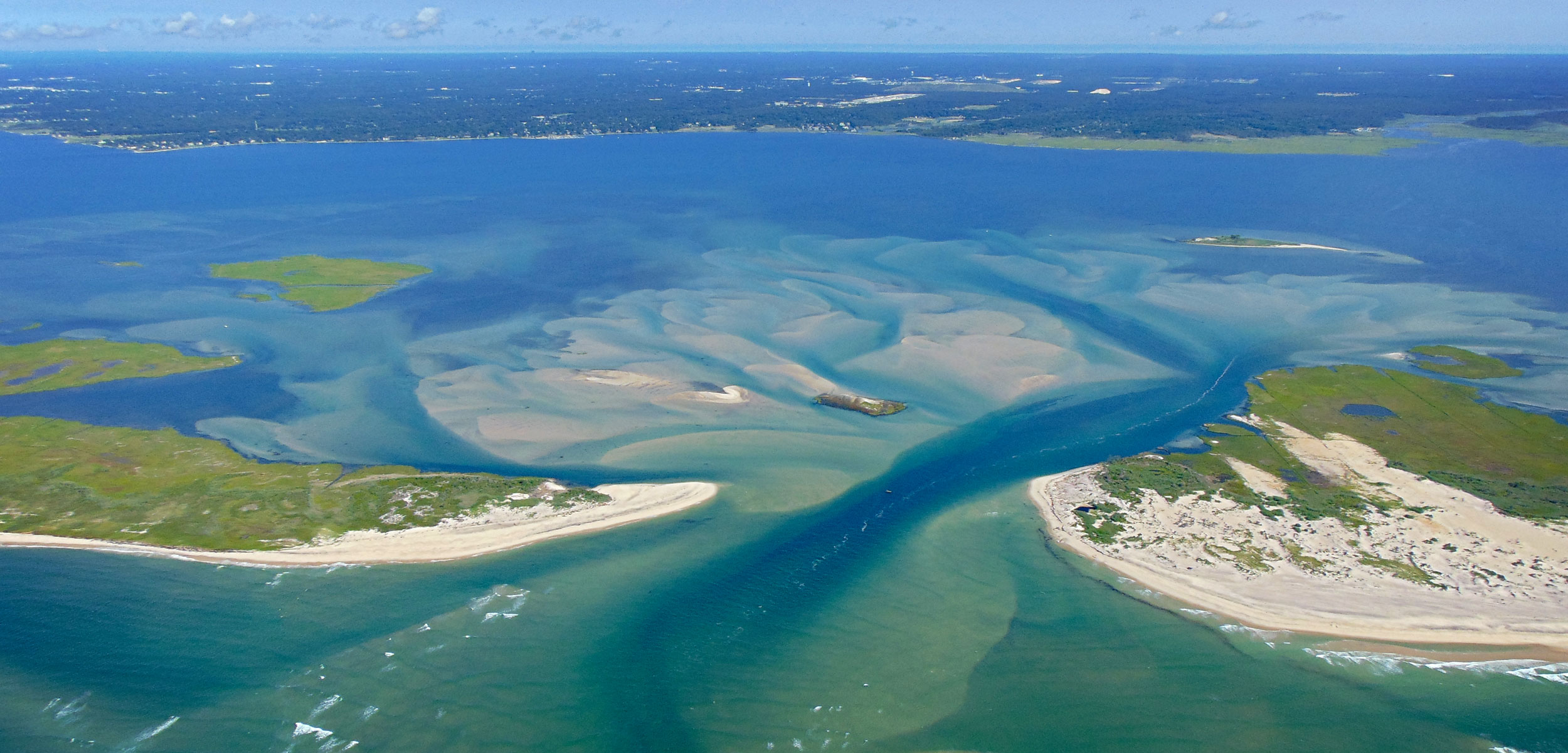aerial photo if the breach in Fire Island