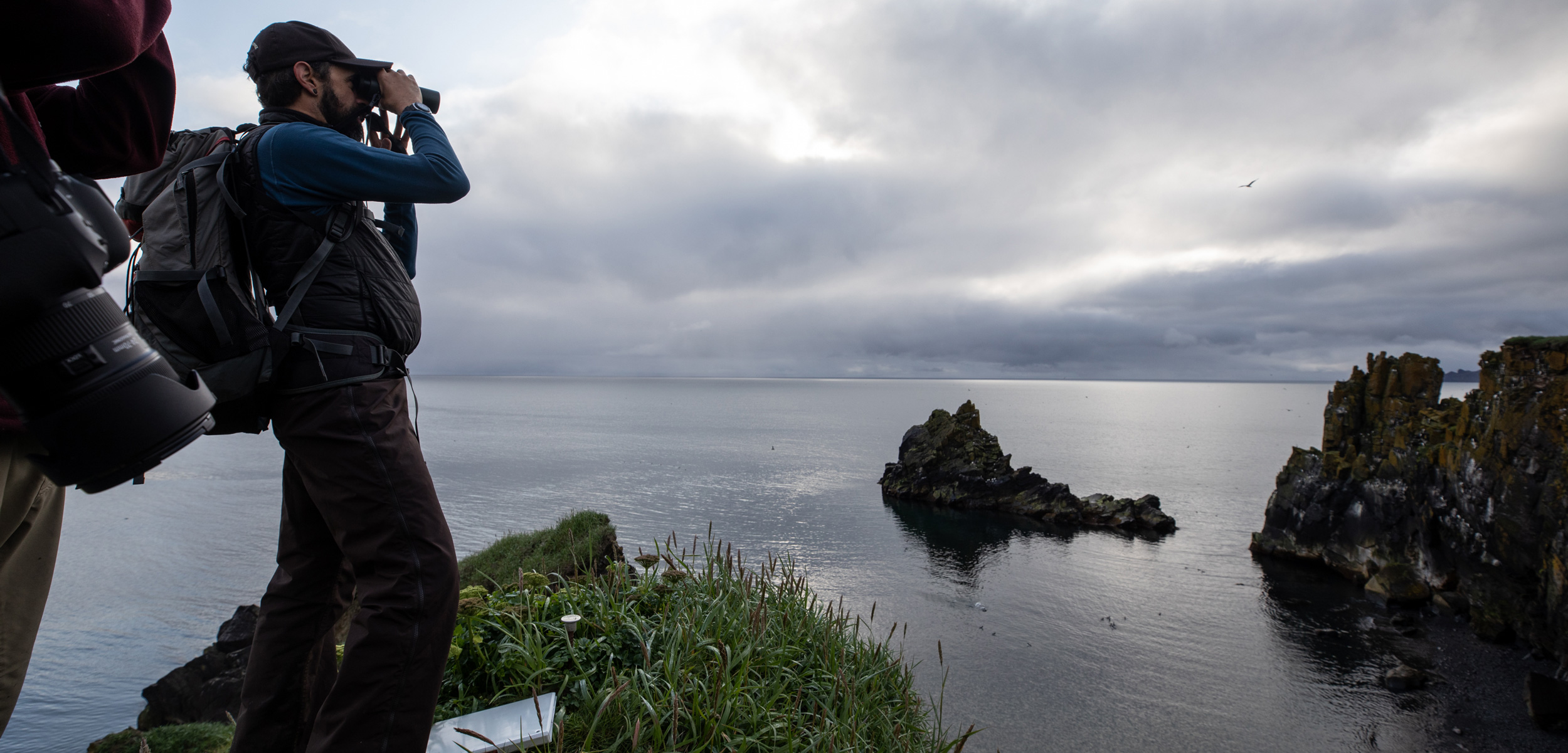 Marc Romano scans for seabirds near St. Matthew Island