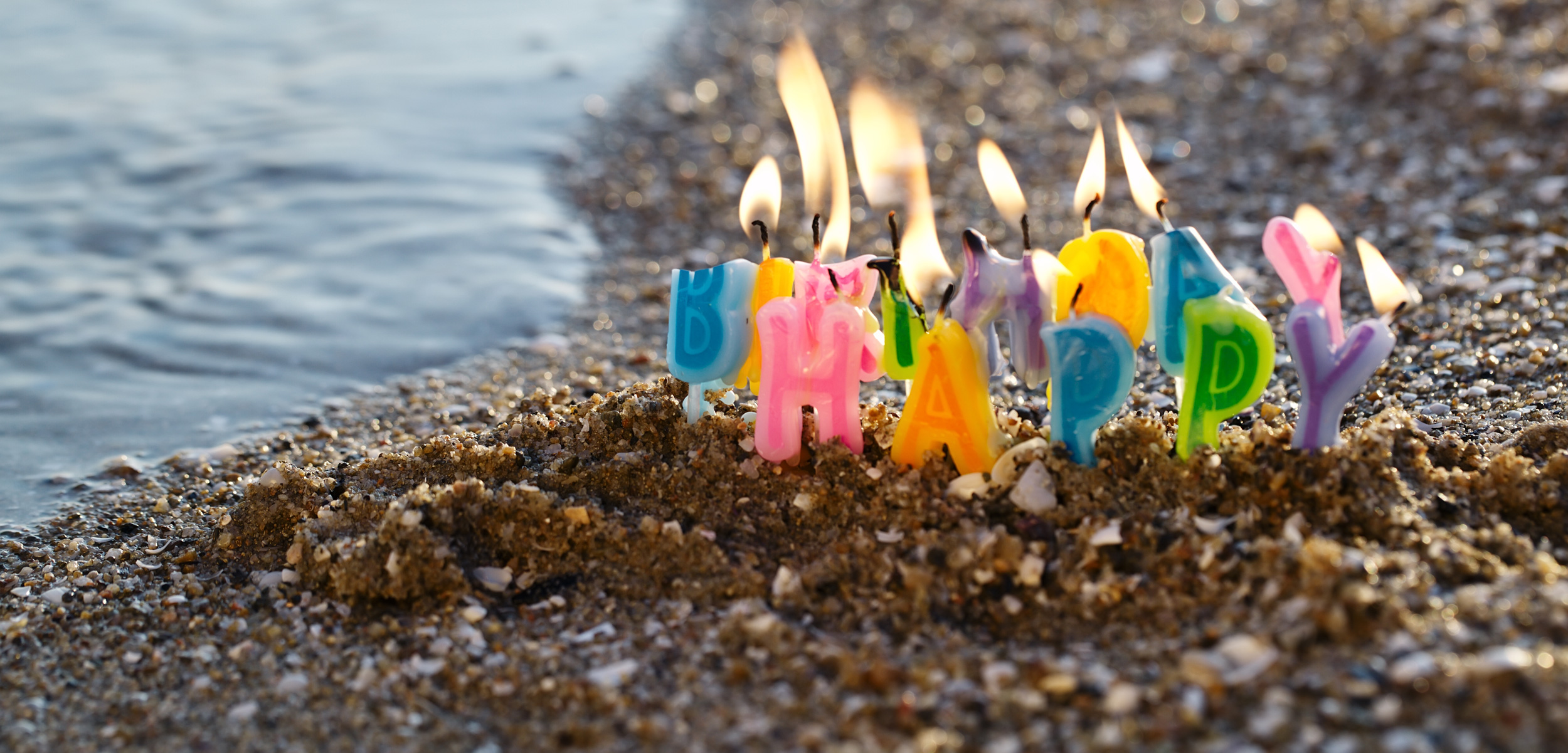 birthday candles on the beach