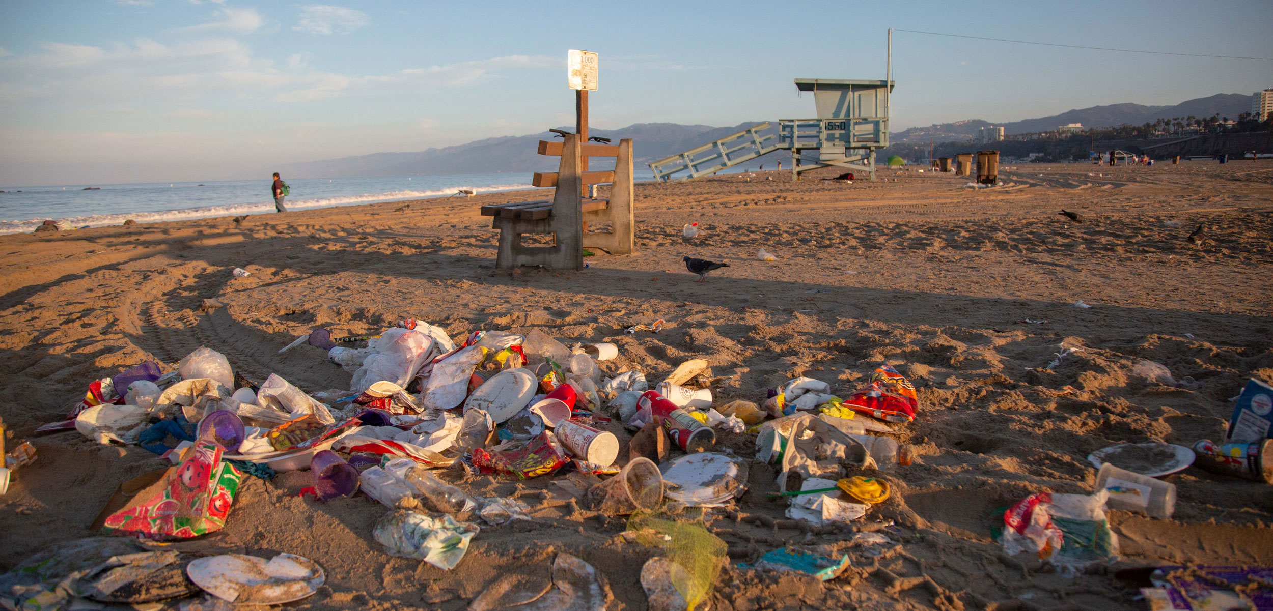Piles of trash at sunrise on Santa Monica Beach, California