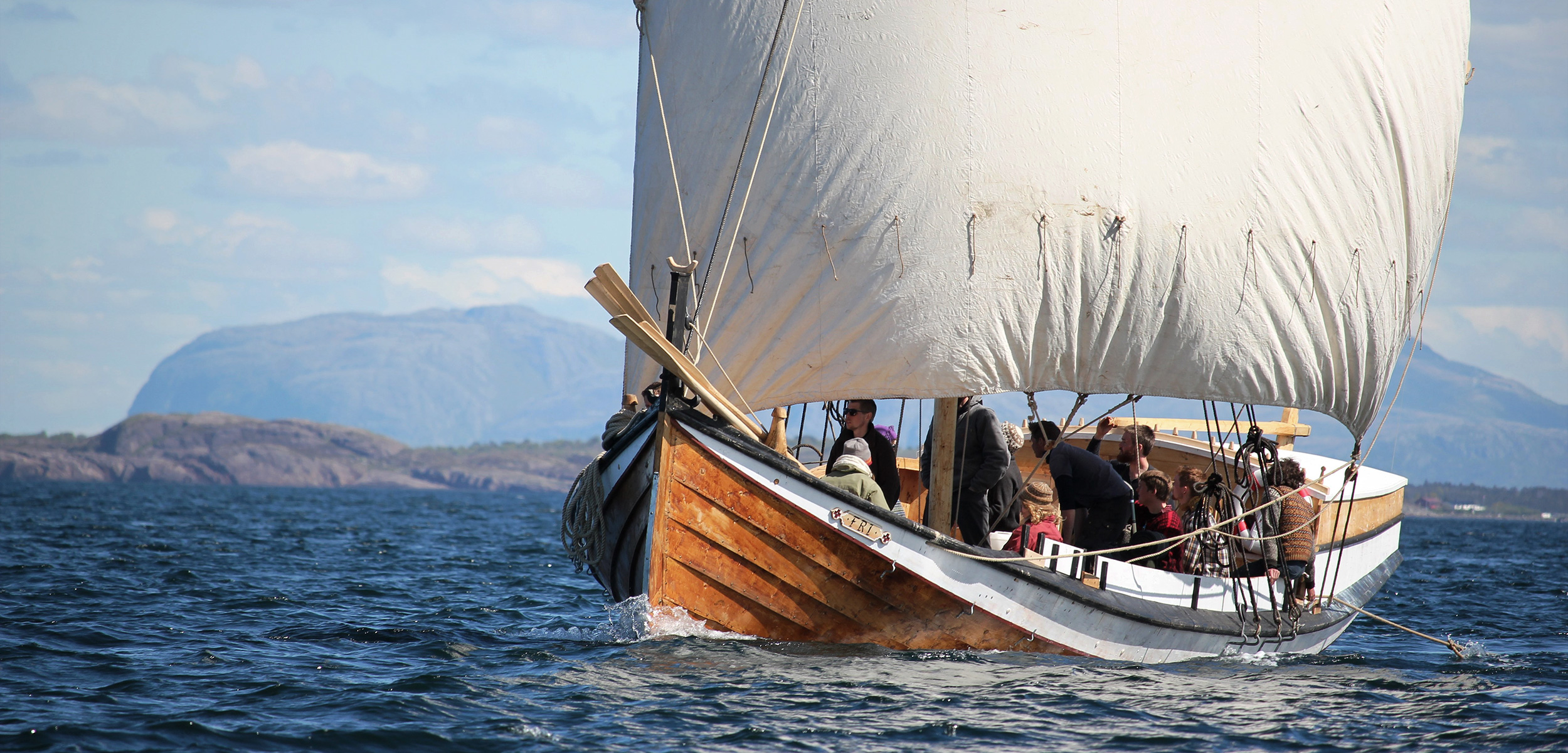 Fosen Folk High School students sailing a square-sail-rigged boat in the Trondheim Fjord. Square sails were the norm in Viking days. Photo by Claire Eamer