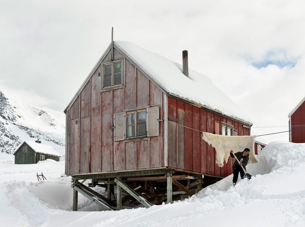 Inuit hunter and his home, Kuummiut, Greenland