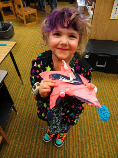 One young Kodiak Island resident shows off her marine debris Christmas decoration. Photo courtesy of Bonnie Dillard
