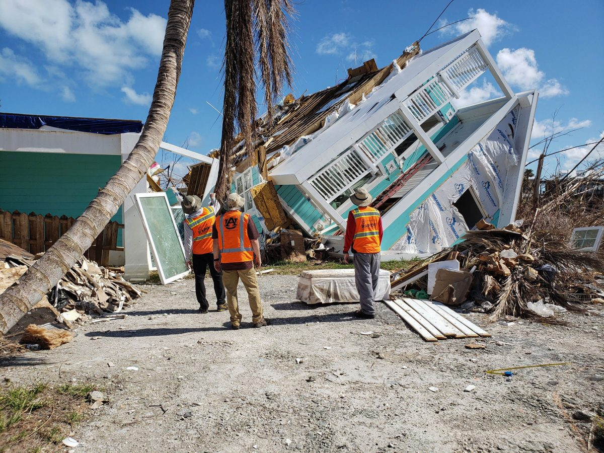 Engineers inspect a damaged building