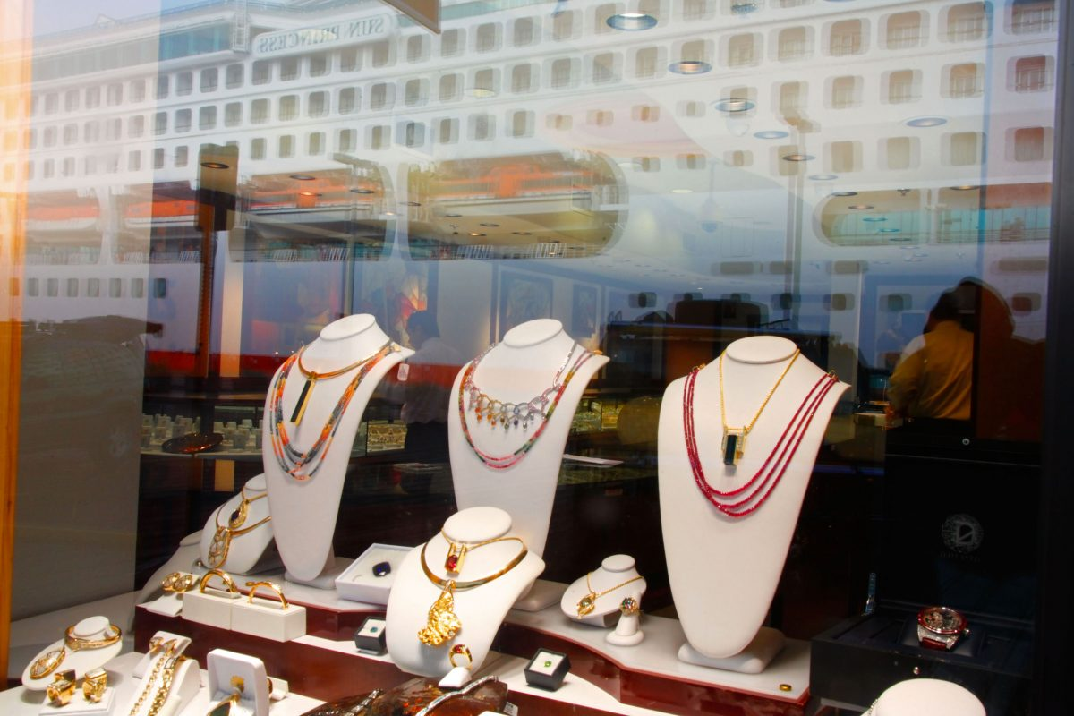 jewelry in shop window with reflection of cruise ship