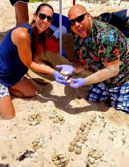 Debbie and Casey Jones excavate a green sea turtle nest after its eggs have hatched, to gather data. Photo courtesy of Casey Jones