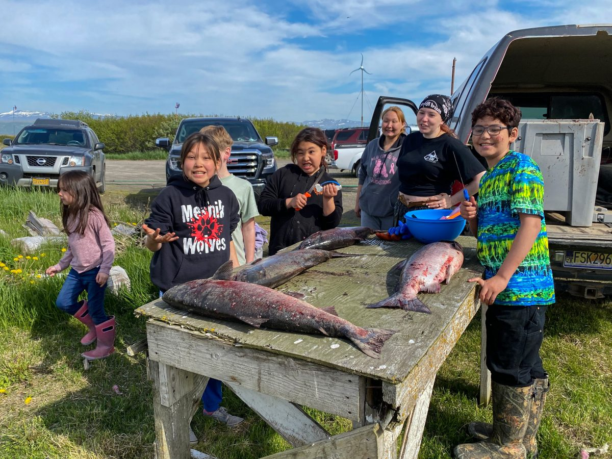 In Port Heiden, Alaska, young workers get ready to head, gut, and filet king salmon, a task that brings the entire family together.