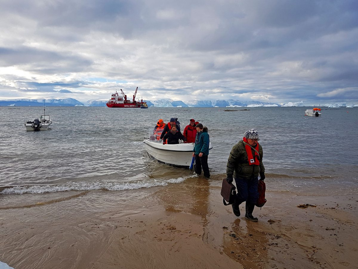 Members of the Pikialasorsuaq Commission are shuttled ashore to attend a meeting in Qaanaaq, Greenland. Photo by Christopher Debicki