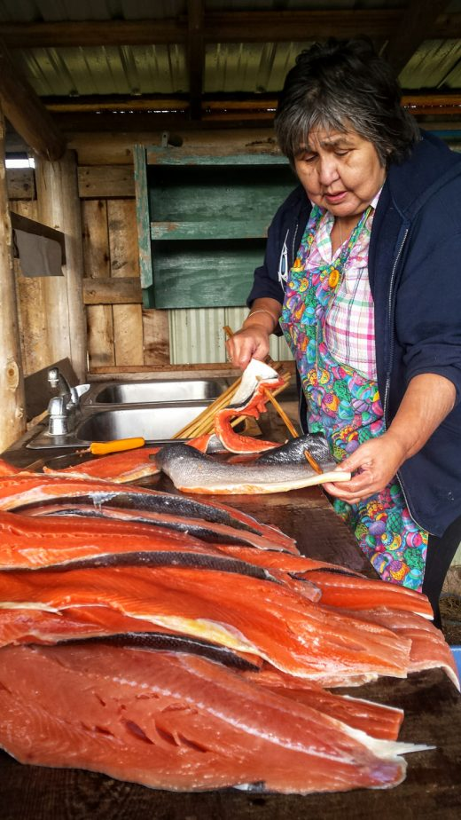 Haida elder Marina Jones preparing smoked salmon