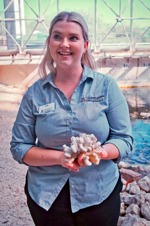 Katie Morgan, manager of marine systems at Biosphere 2, holds a dead piece of coral left over from earlier research in the replica ocean.