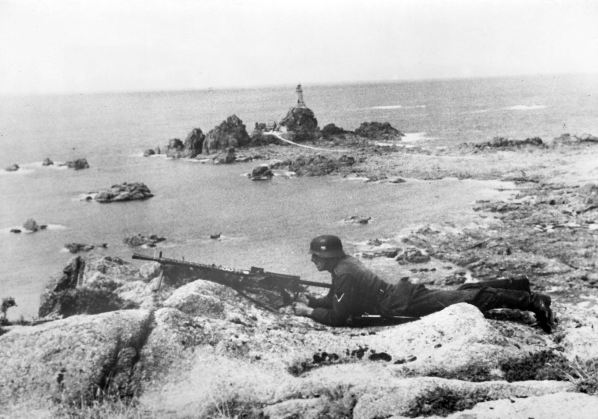 Nazi propaganda image depicts a guard soldier of the German Wehrmacht near La Corbière on the coast of the English Channel Jersey