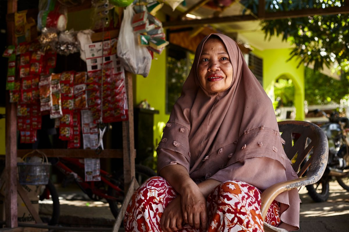 Nilawati, a tsunami survivor, runs a small grocery shop in a village built inland by an aid agency, but many of her neighbors have moved away.