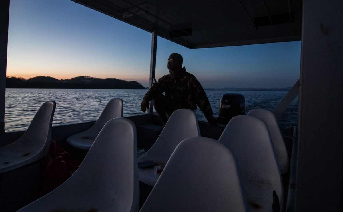 A fisherman returns home after a night on patrol around the responsible fishing zone near Port Nispero, Costa Rica