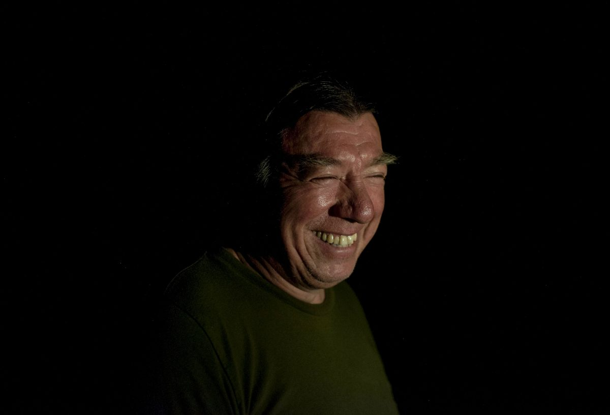 nighttime portrait of Kerry Prosper during an eel fishing trip