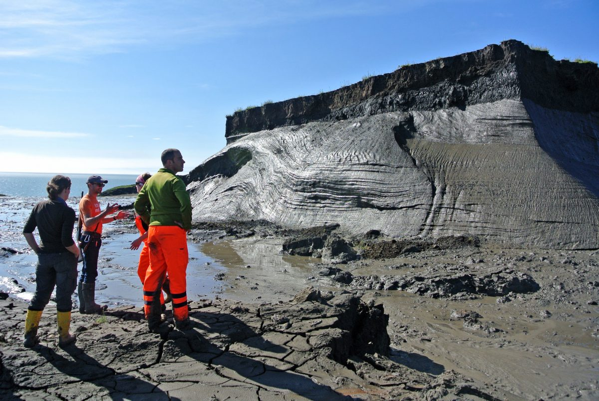 researchers examine permafrost slump