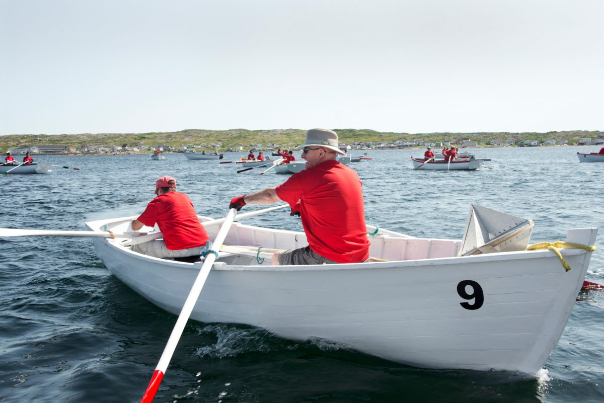 Racers navigate to the starting line during the Great Fogo Island Punt Race To There and Back. Photo by Shanna Baker