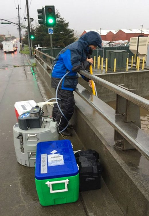 researcher sampling storm water