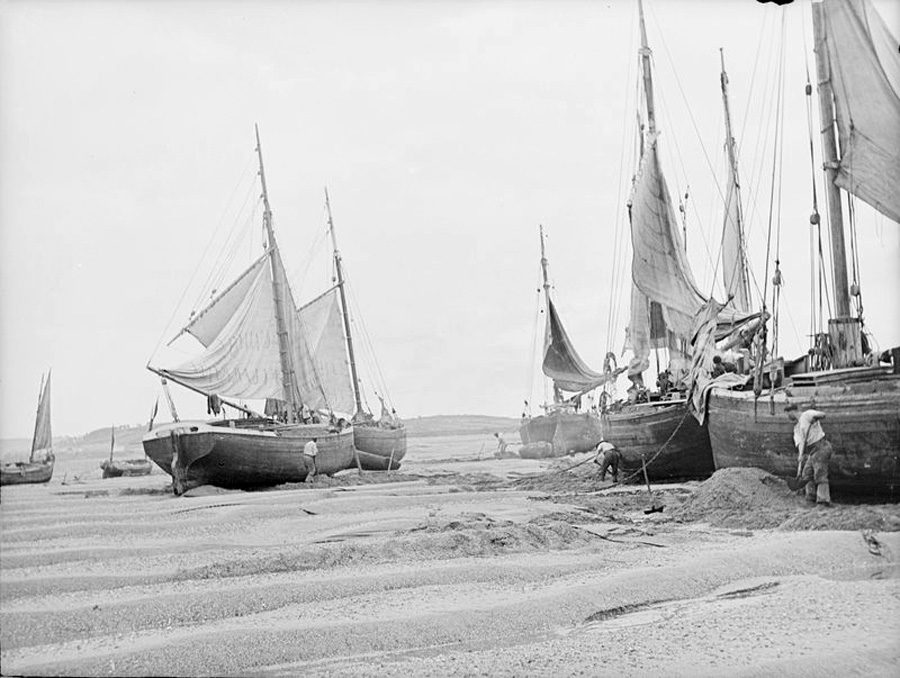 Ships aground at North Devon, England, circa 1900, take on sand and gravel as ballast. Photo courtesy of the National Maritime Museum, Greenwich, London
