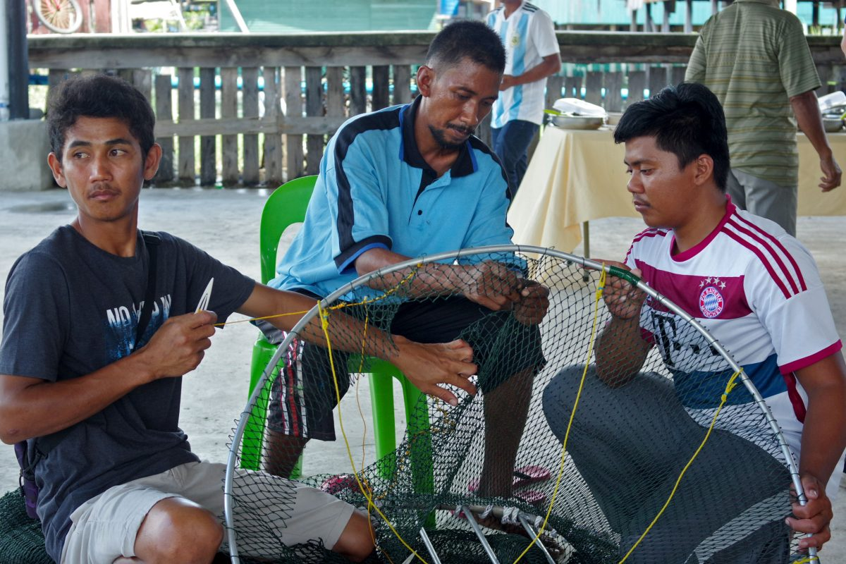 Fishermen at a Marine Research Foundation workshop in coastal Sabah, Malaysia, build a turtle excluder device