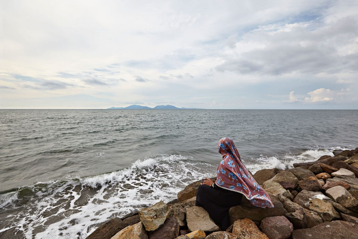 A woman gazes out at the Indian Ocean from the Indonesian province of Aceh, nearly 15 years after a tsunami devastated the region.