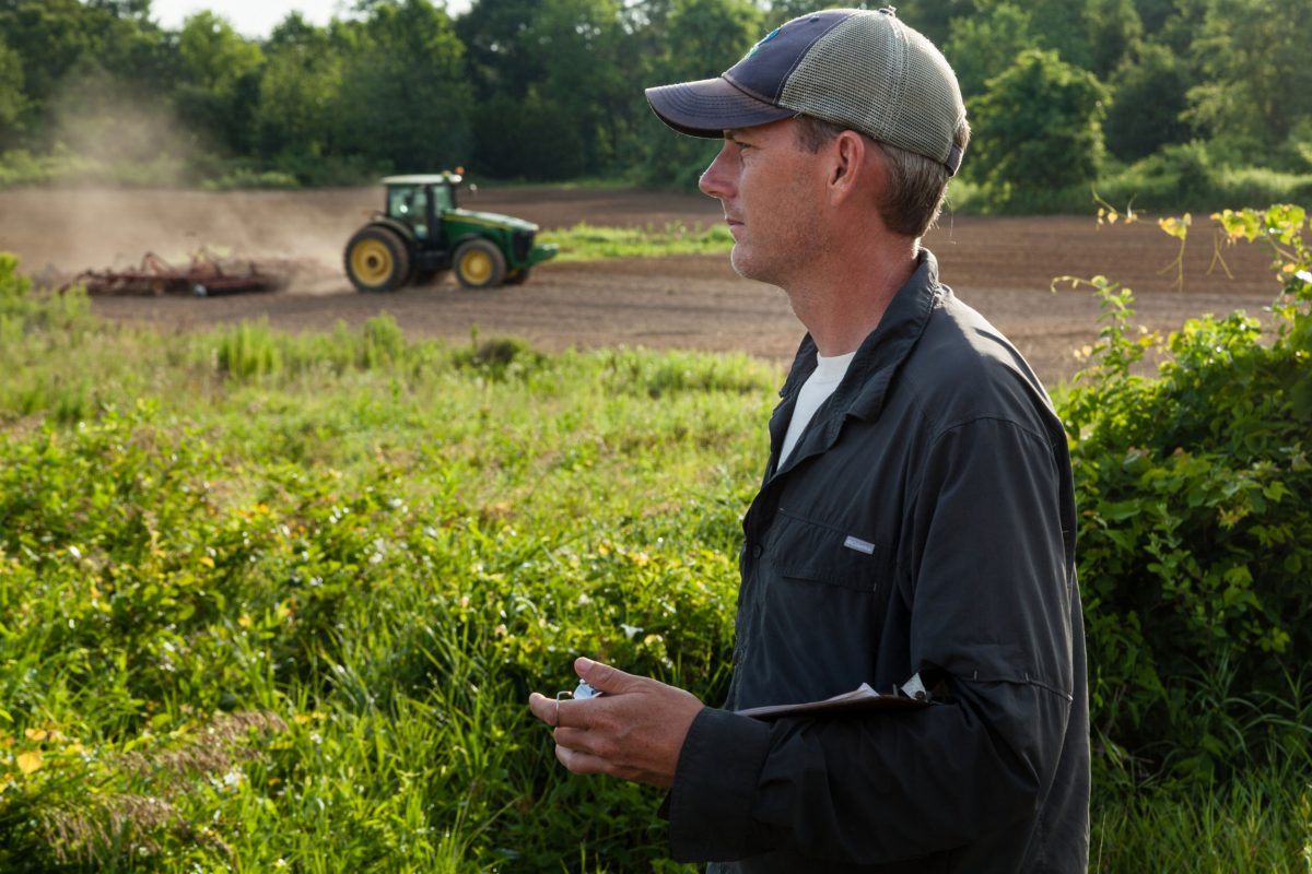 Ecologist Dan small surveys a farm