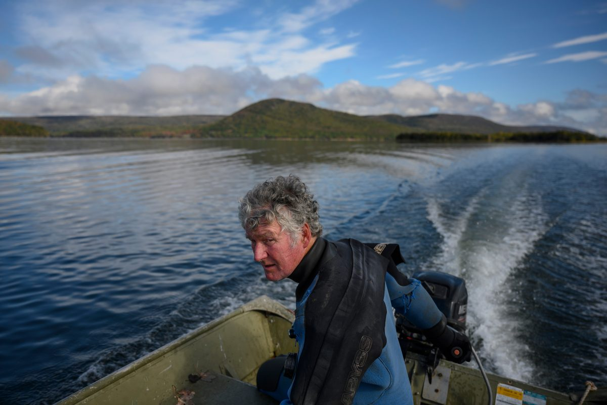 Robin Stuart, an aquaculture consultant who contributes to Beresford's research, navigates to a test site on Bras d'Or Lake.