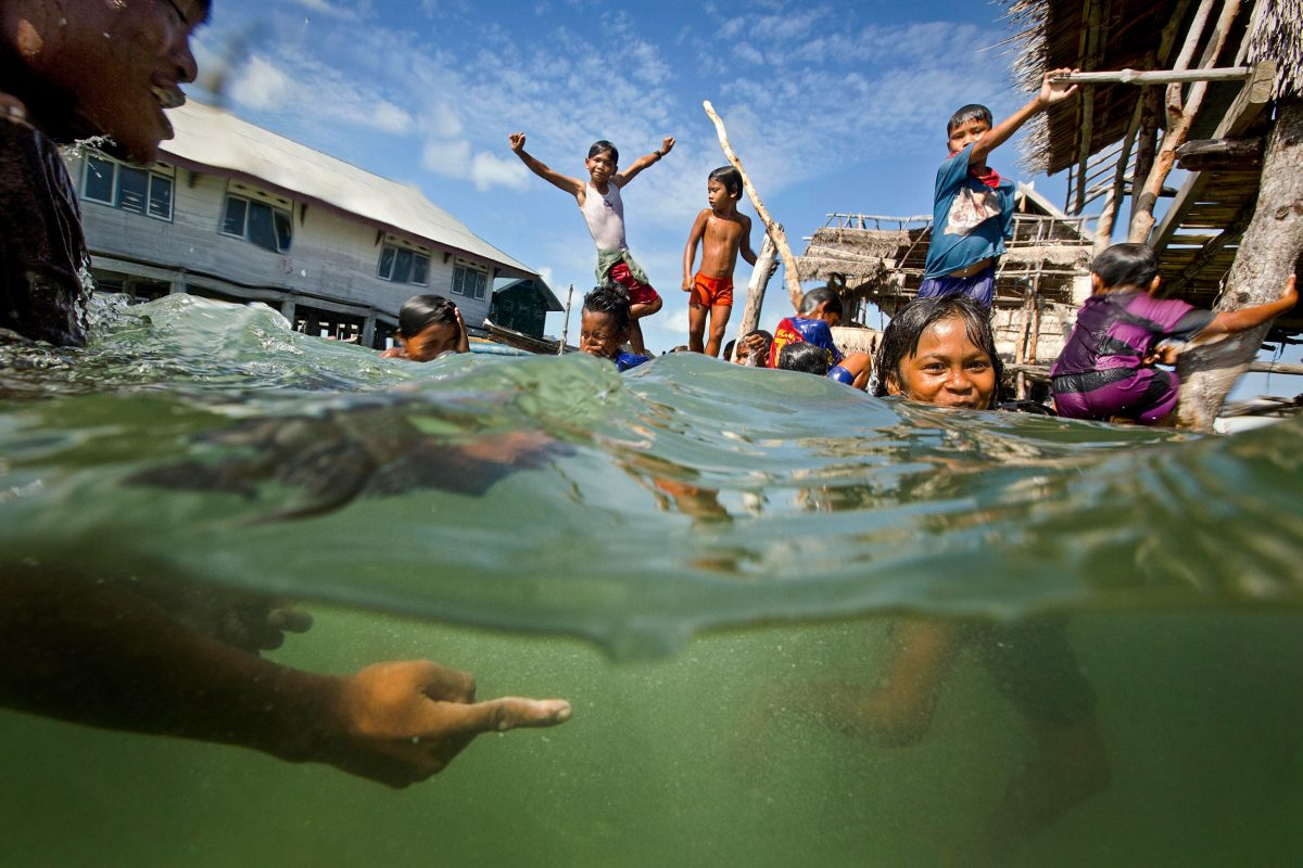 Bajau kids swimming in Sampela, Indonesia