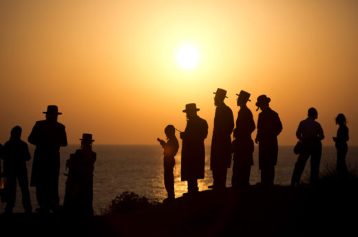 Ultra-Orthodox Jews perform the Tashlikh ritual on a beach in Herzliya, a city outside of Tel Aviv, Israel. Photo by Abir Sultan/epa/Corbis