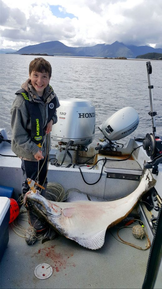 Thomas Barlow with a halibut he caught with the hook he made