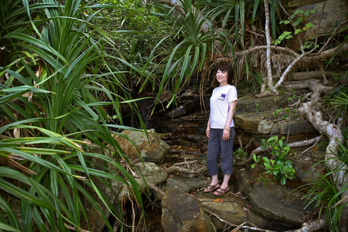 Kumi Togawa standing near water along Haemida beach on southern Iriomote Island