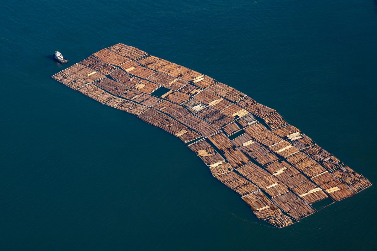 aerial photo of a tug pulling lumber in Howe Sound, British Columbia