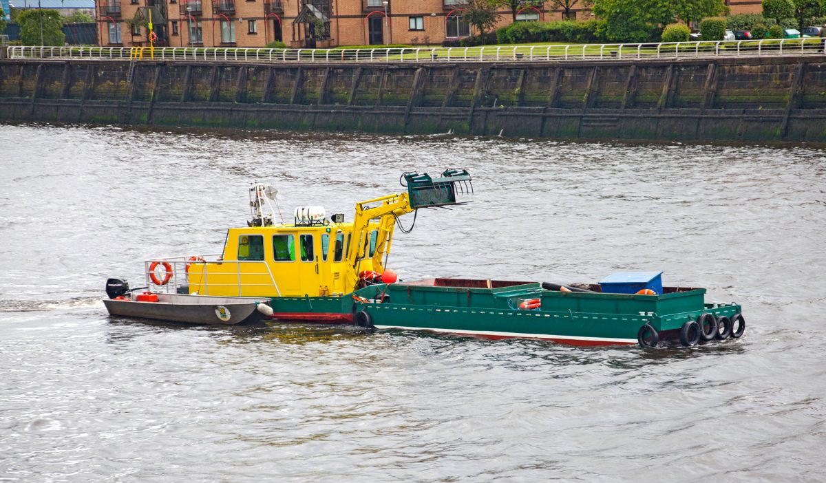 'Water Witch' vessel which cleans debris brought to the River Clyde in Glasgow