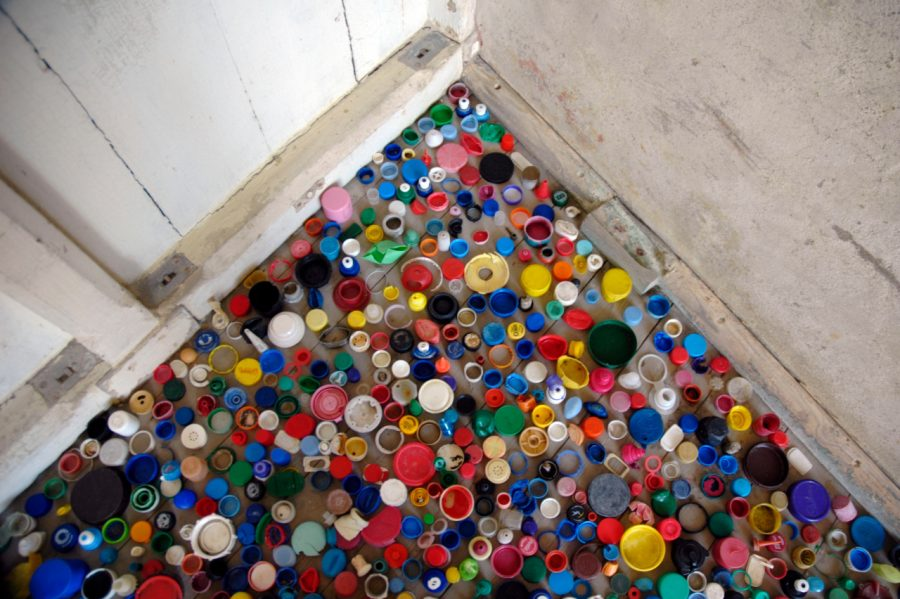 This view from above shows a portion of the thousands of bottle tops artist Fran Crowe used for an installation, shaped like a wave, at a local fort. Photo courtesy of Fran Crowe