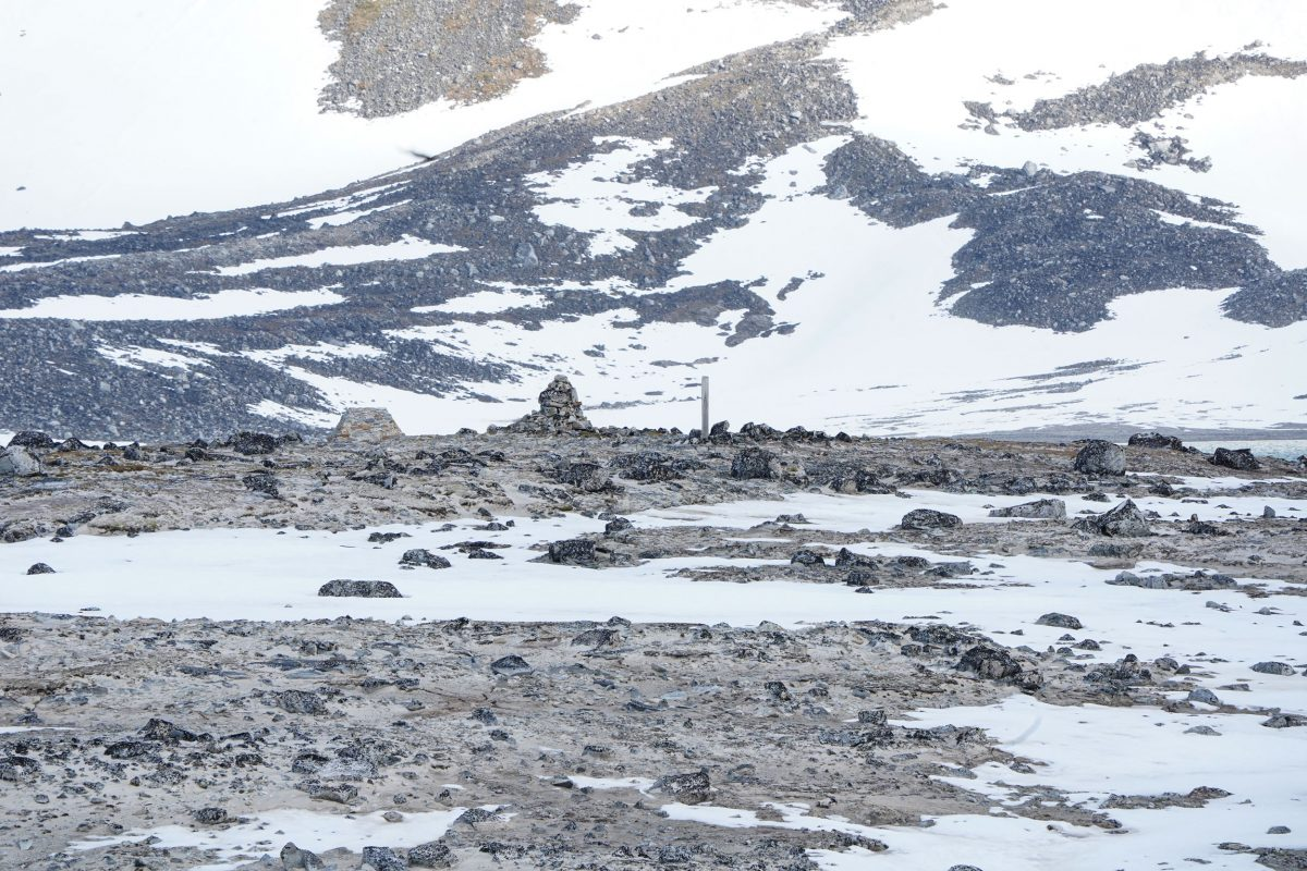 Stones and wood mark whalers' graves at Gravneset on Spitsbergen, Svalbard