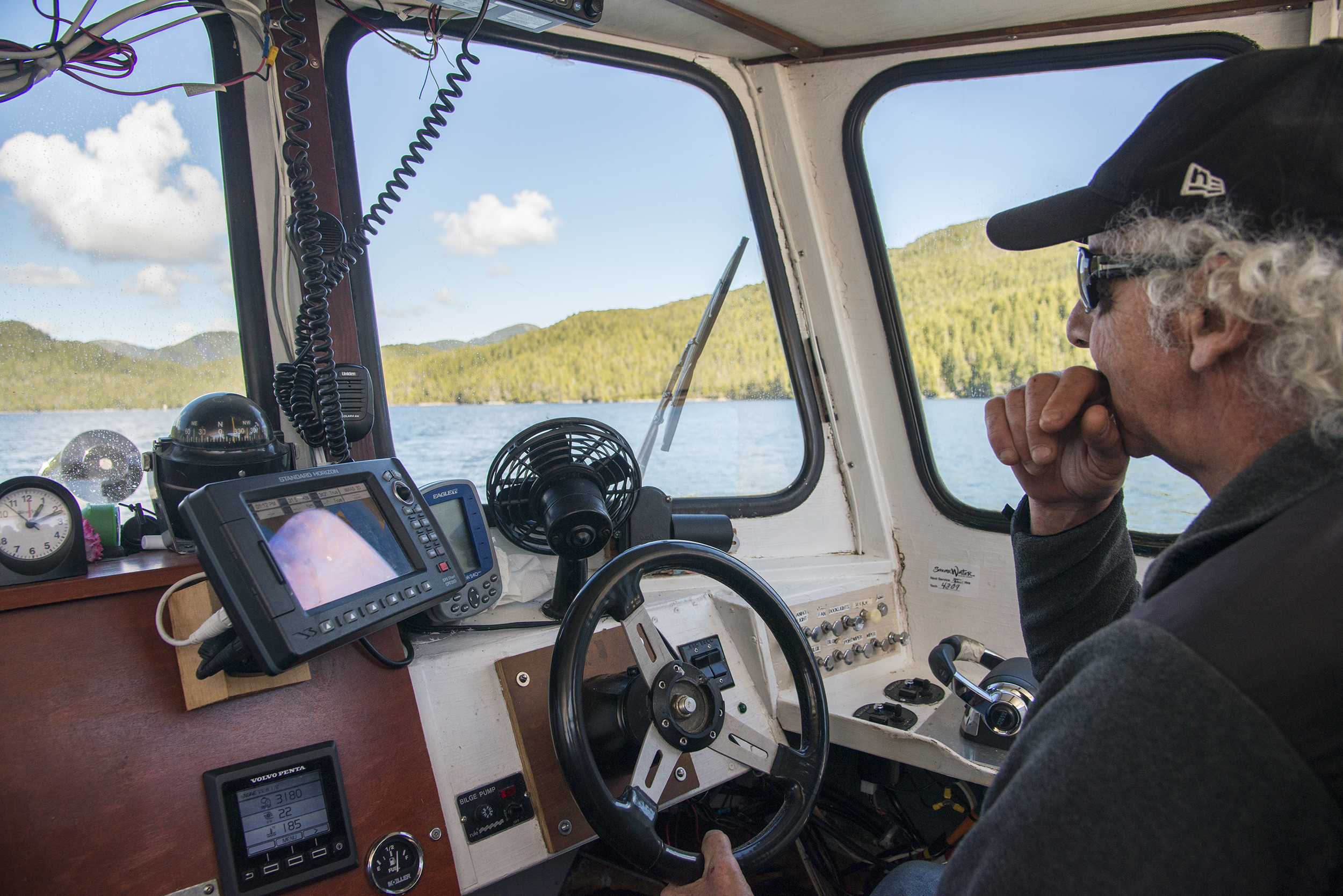 Skipper Bob Martin steers the <em>Northern Lights</em> along British Columbia's north coast. Photo by Shanna Baker