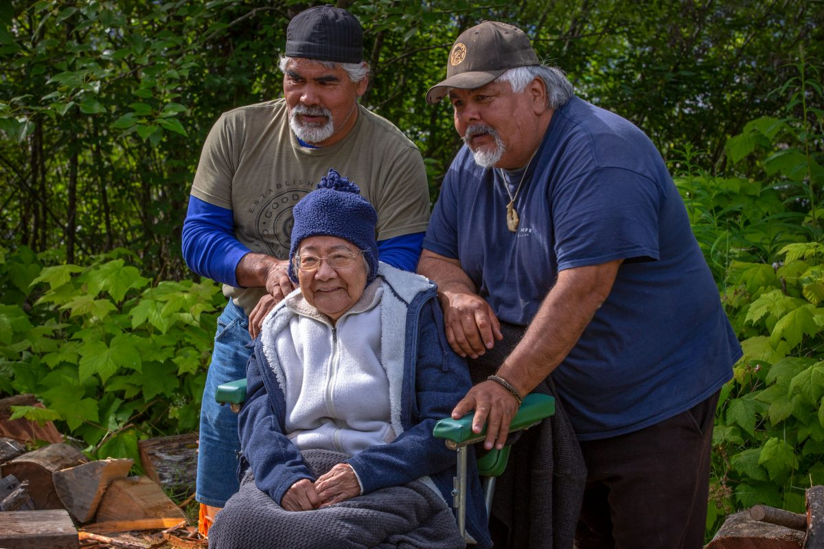 Ted Walkus, right, brother Dwayne, and their aunt Evelyn Windsor, a Wuikinuxv elder and cultural treasure at Second Narrows, near Windsor's birthplace in Wuikinuxv territory.